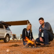 couple sitting at fire near 4wd with canopy - Offroad 4x4 accessories